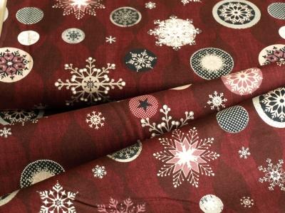 Látky Patchwork - Vánoční vločky na tm. červené