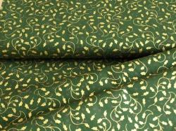 Látky Patchwork - Zlaté lístečky na tmavě zeleném podkladu