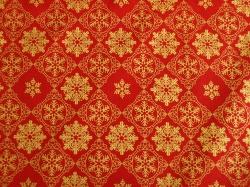Látky Patchwork - Vločky na červeném podkladu