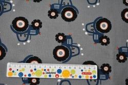 Látky Patchwork - Modré traktory na sv. šedém podkladu