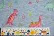 Látky Patchwork - Dinosauři na světle modrém podkladu
