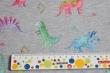 Látky Patchwork - Dinosauři na světle šedém podkladu